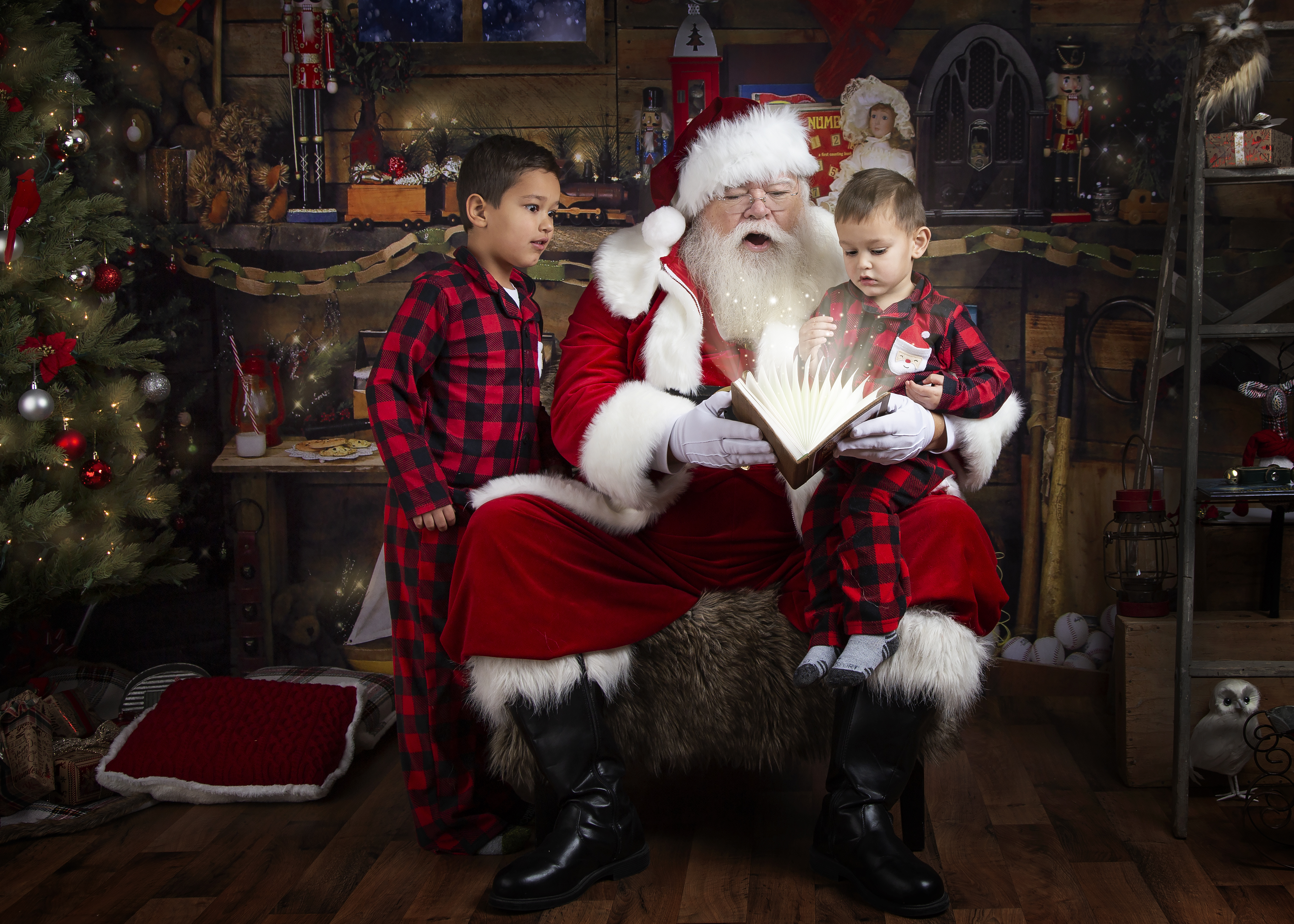 Boys surprised by Santa's naughty or nice book