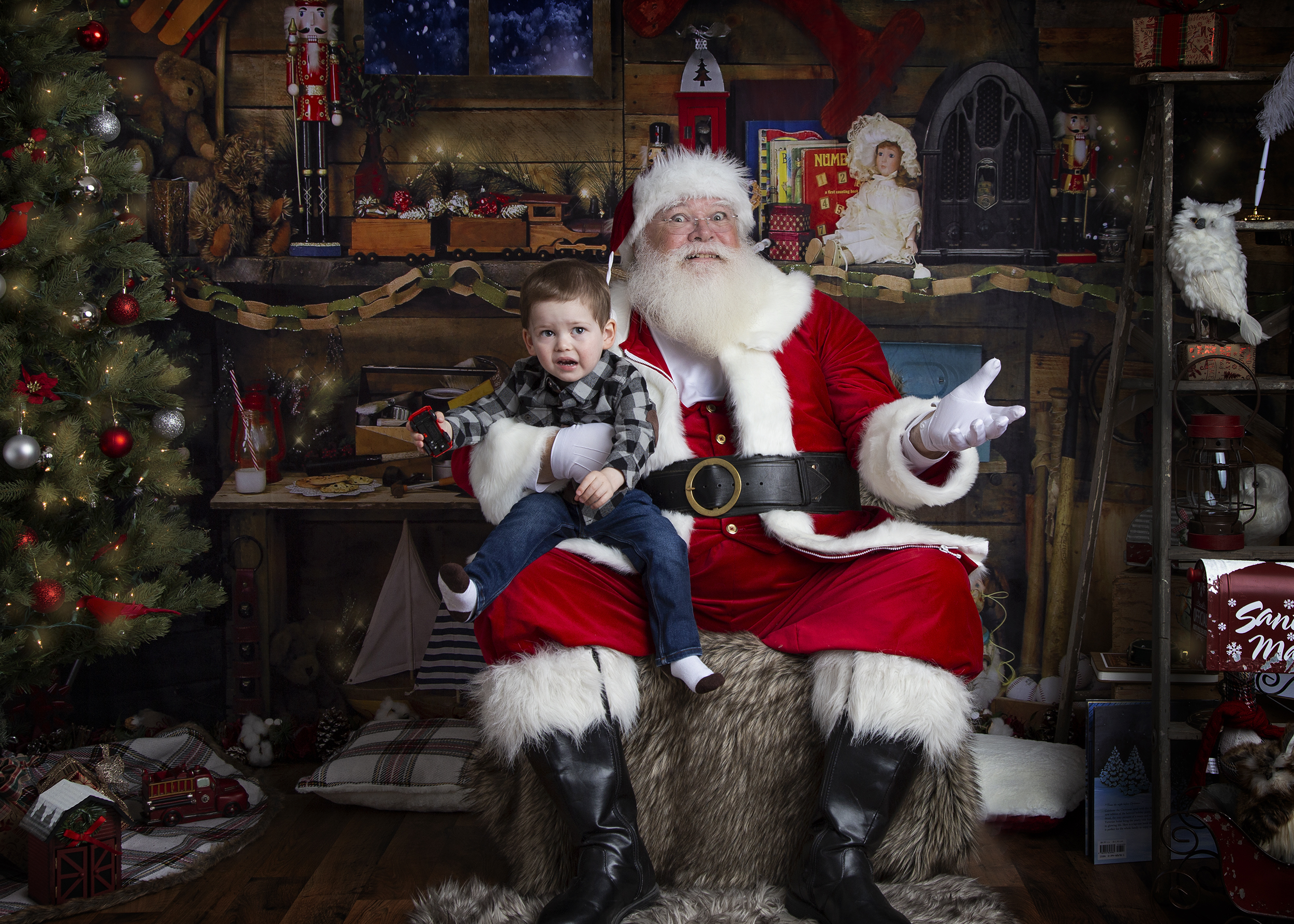 Santa playing with crying child