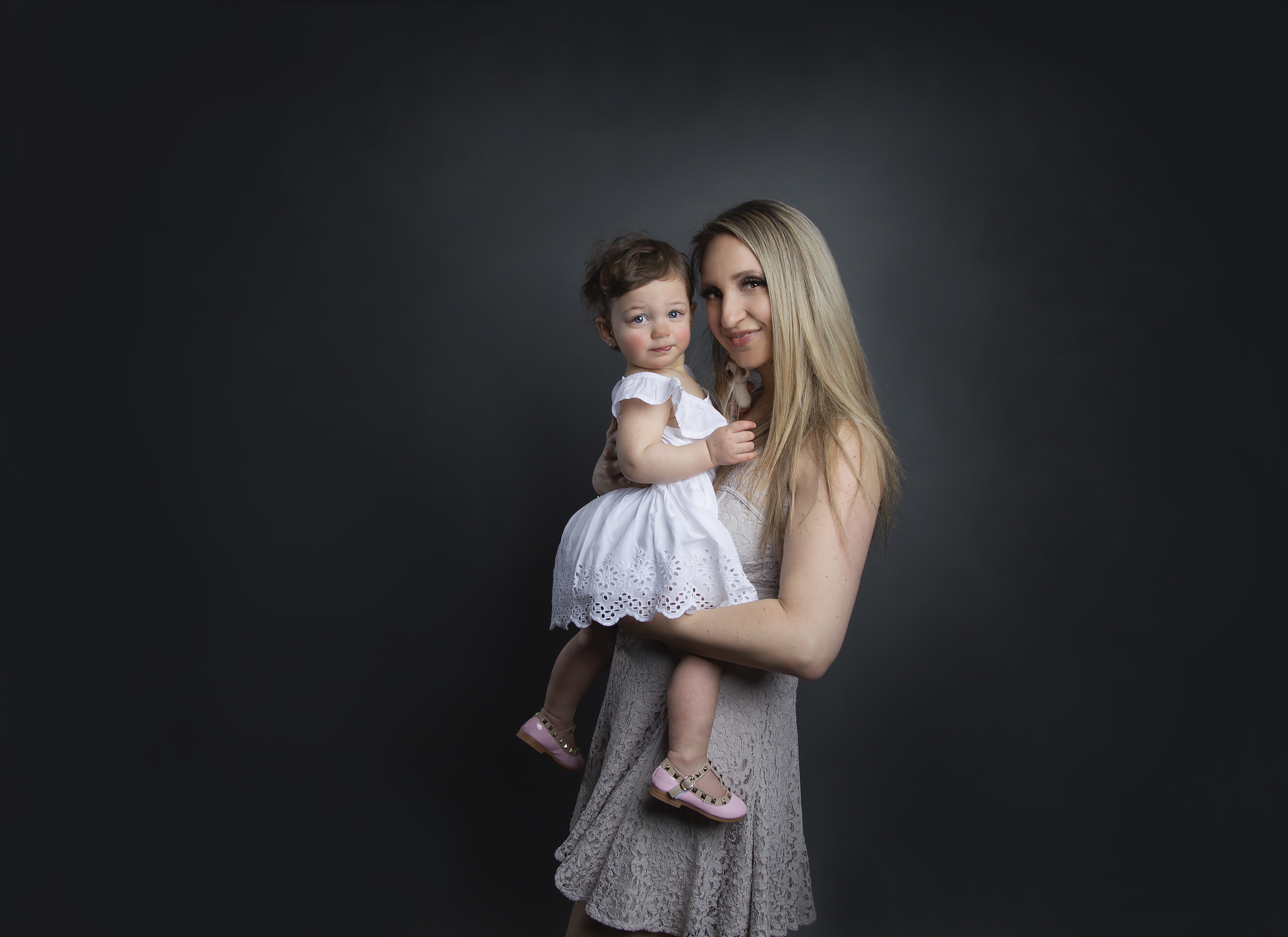 Girl in mother's arms