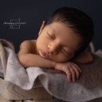 sleeping in basket baby
